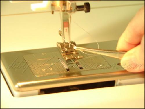 Tweezers threading a needle