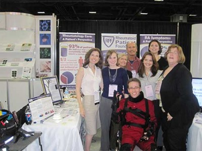 Volunteers at RPF ACR exhibit with Dr. John Davis