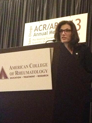 Kelly Young at podium at ACR13 speaking on Engaging Patients as Partners