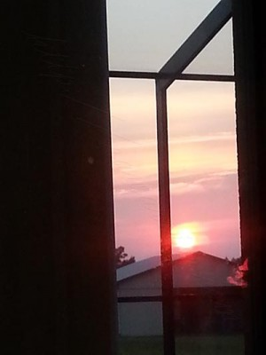 Sunset over barn - awesome even via narrow window