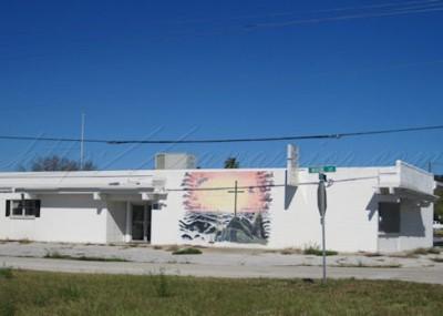 cross mural on building