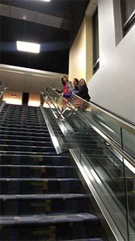 RPF volunteers on escalator