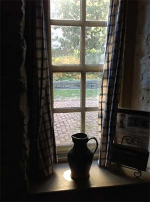 pitcher in window of stone house in Georgetown